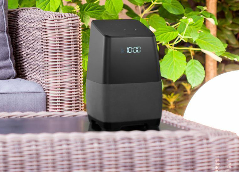 An image of a smart speaker on an outdoor patio set, as part of a smart speaker deal during August of 2018.
