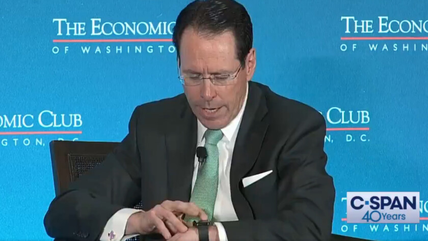 A screenshot of a C-SPAN video where AT&T's CEO gets a robocall live on stage.