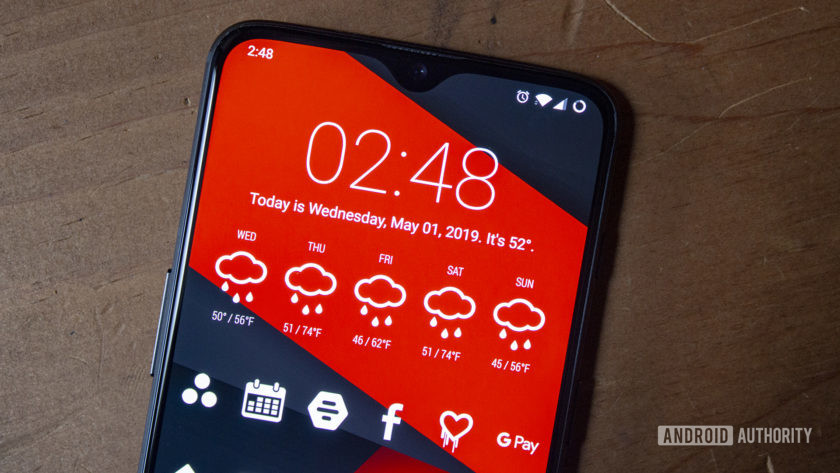 A OnePlus 6T with a customized Android home screen.