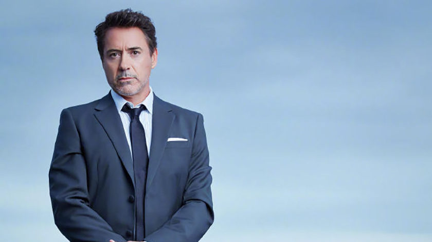 Actor Robert Downey Jr. holding a OnePlus 7 Pro in a promotional photo for the company.