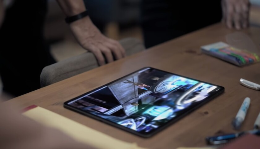 A photo of an iPad showing a game developed by the Final Fantasy creator.