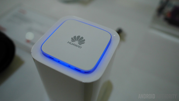 The Huawei logo surrounded by a blue light.