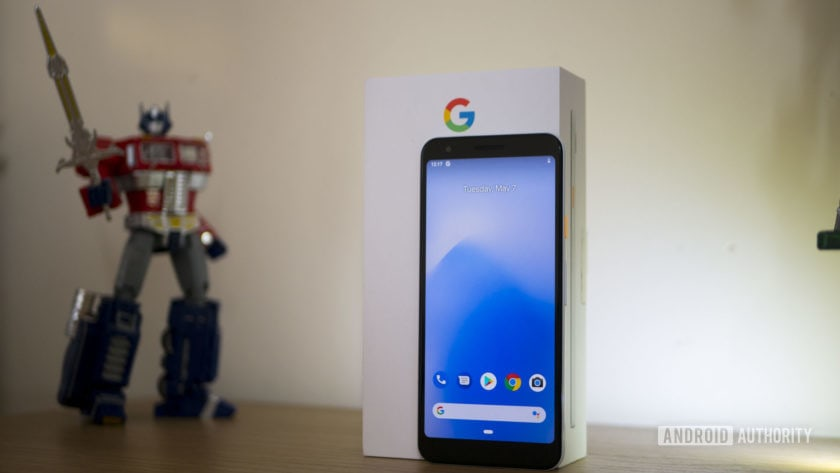 Pixel 3a handset standing on a table in front of its retail box.