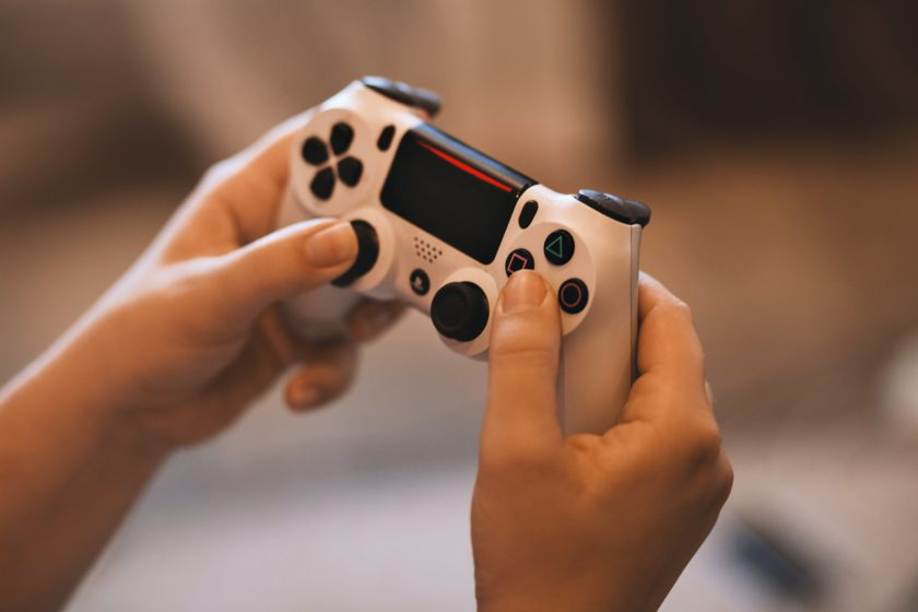Person Holding Sony Ps4 Controller