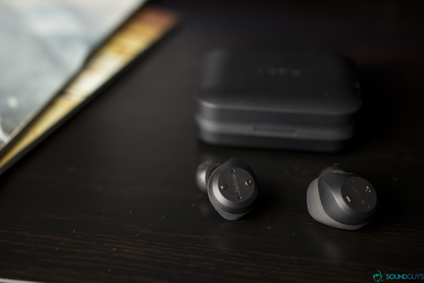 The Jabra Elite 65t in front of its charging case.