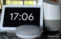 Photograph of Google Home Hub, Home Mini, and Home side by side