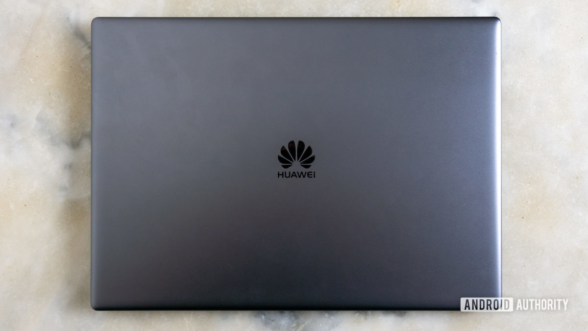 Closed Huawei Matebook X Pro laptop on marble table