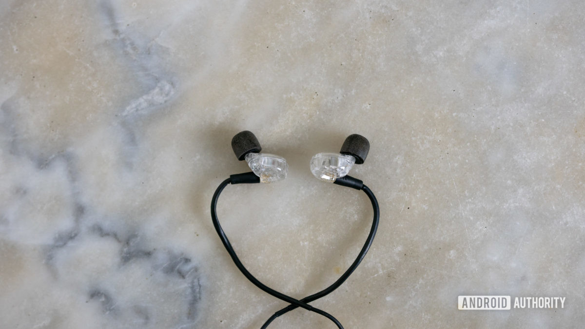 ADV.Sound Model 3 in ears with memory foam ear tips on marble table
