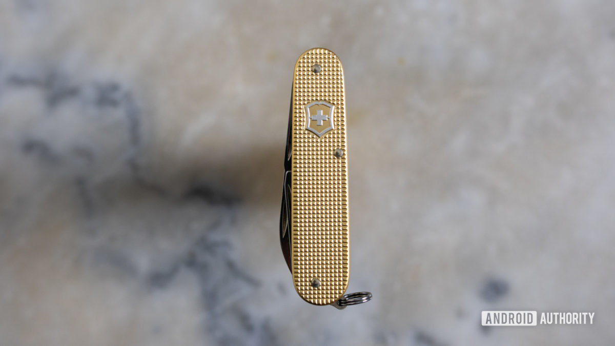 Gold Victorinox Cadet multitool on a marble table