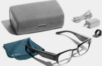 A promotional photo of the Focals smart glasses with all its accessories.