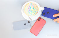 Smartphones on table next to colorful coffee