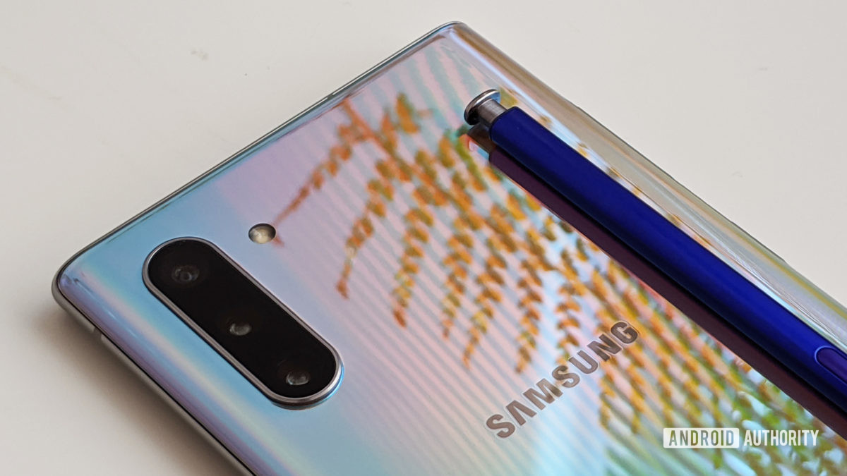 Samsung Galaxy Note 10 camera and S Pen with fern reflection