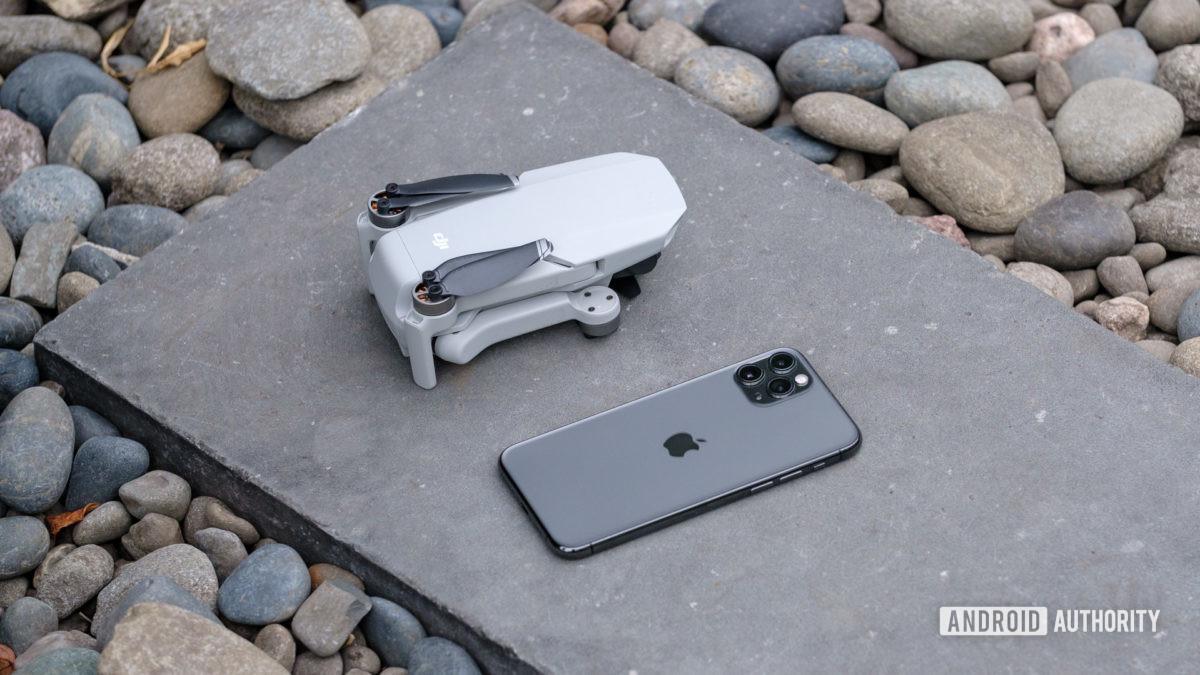 DJI Mavic Mini folded on ground vs iPhone 11 Pro Max