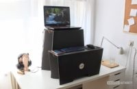 A monkey desk by room in a box cardboard standing desk on top of a white desk