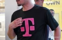 A T-Mobile employee wearing a black t-shirt with the T-Mobile logo.