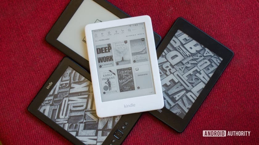 Amazon Kindle 2019 placed on top of older kindles