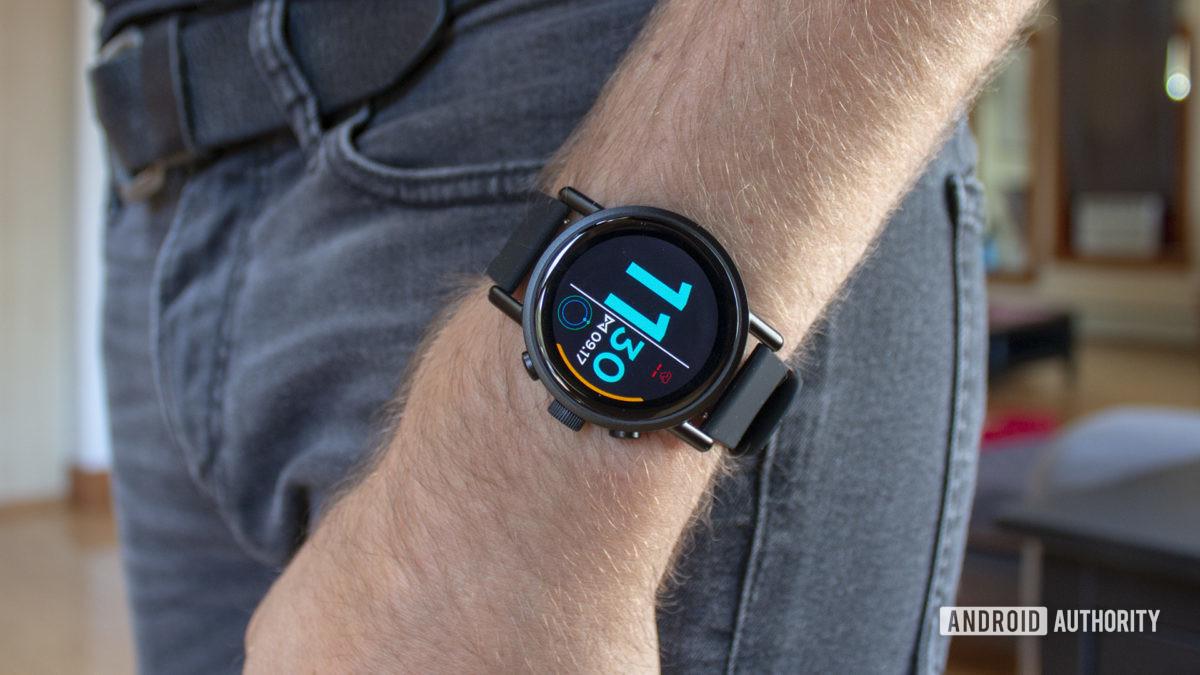 Misfit Vapor X Smartwatch On Wrist Resting On Side Of Body