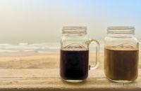 Coffee mugs by the beach