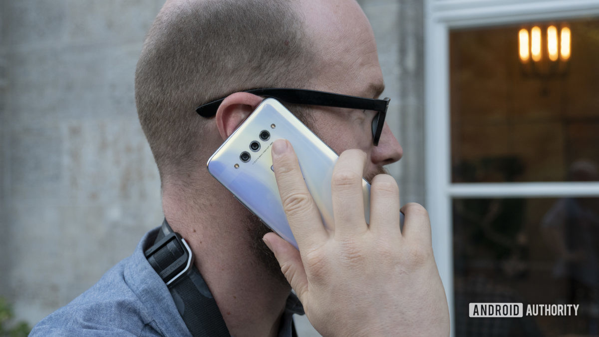 TCL Plex hands on white in hand phone call up to ear