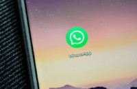 A WhatsApp app icon closeup on a smartphone.