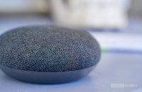 Google Nest Mini charcoal on purple table