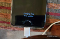 Samsung Galaxy Note 10 charging on the sofa