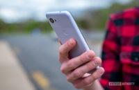 Google Pixel 3a Purple-ish Holding Phone